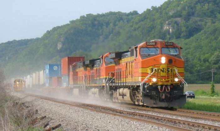 Train: A series of rail vehicles, including a locomotive, for transporting cargo and/or passengers